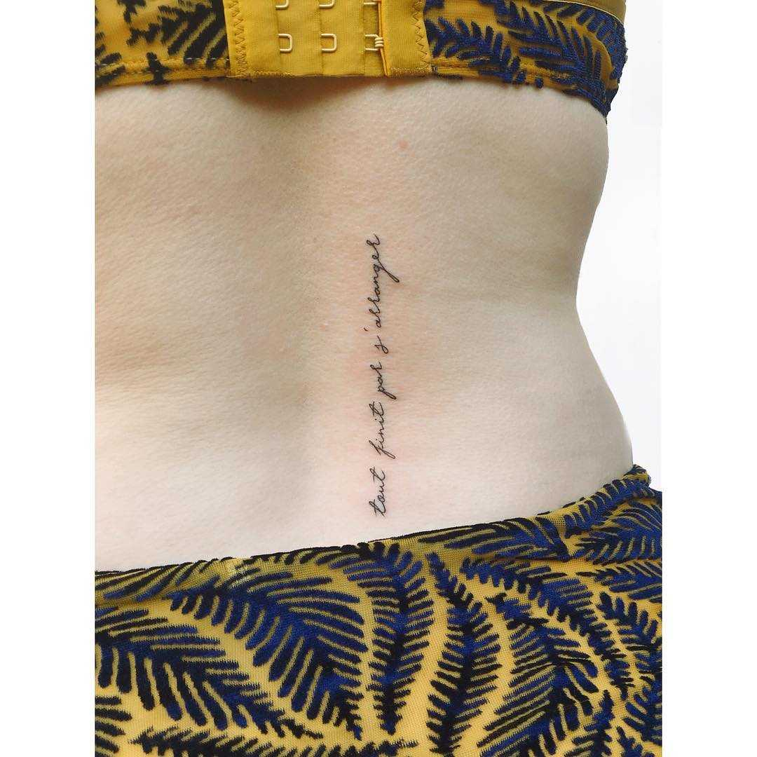 French quote tattoo on a back by Zaya Hastra
