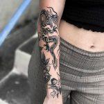Fun dragon tattoo by Javier Betancourt
