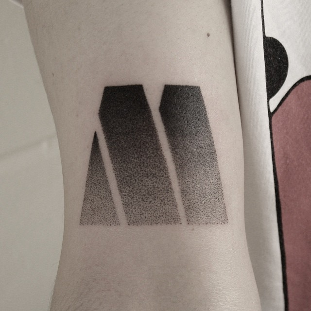 Gradient M tattoo by Oliver Whiting