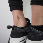 Hand-poked ankle piece by Lara Maju