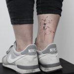 Hand-poked coffee plant tattoo by Lara Maju