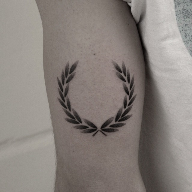 Hand-poked laurel wreath tattoo by Oliver Whiting