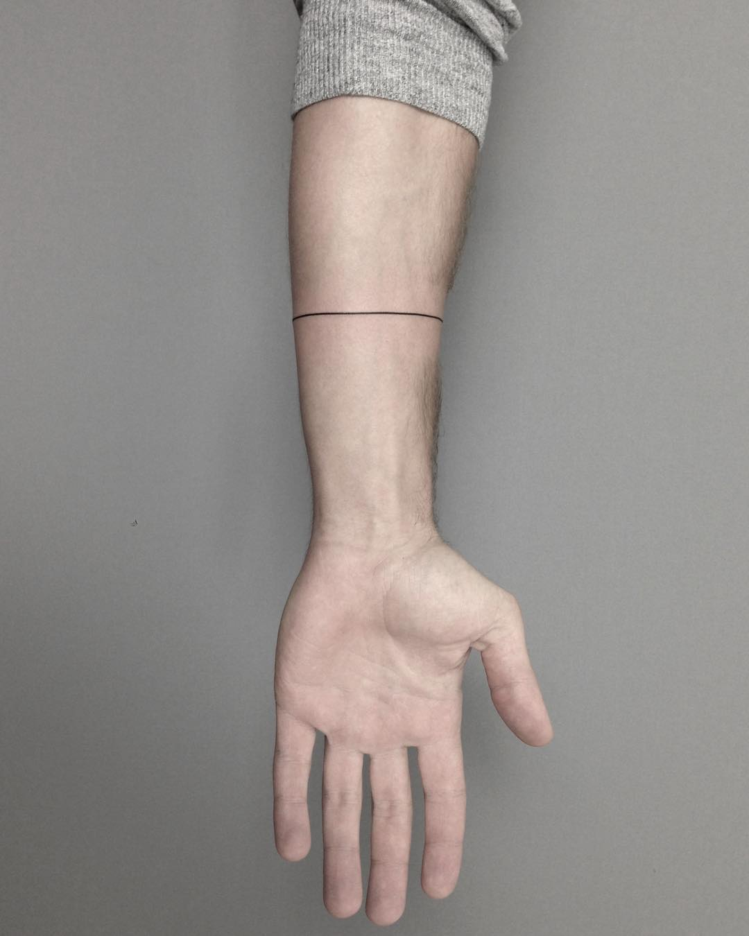 Hand-poked line tattoo by Lara Maju