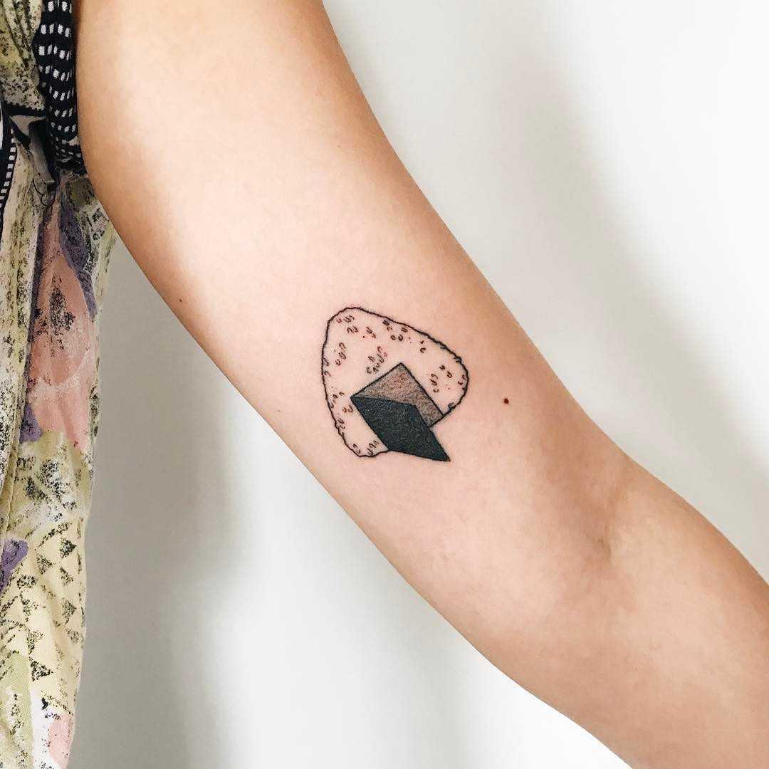Hand-poked open door onigiri tattoo by Kelli Kikcio