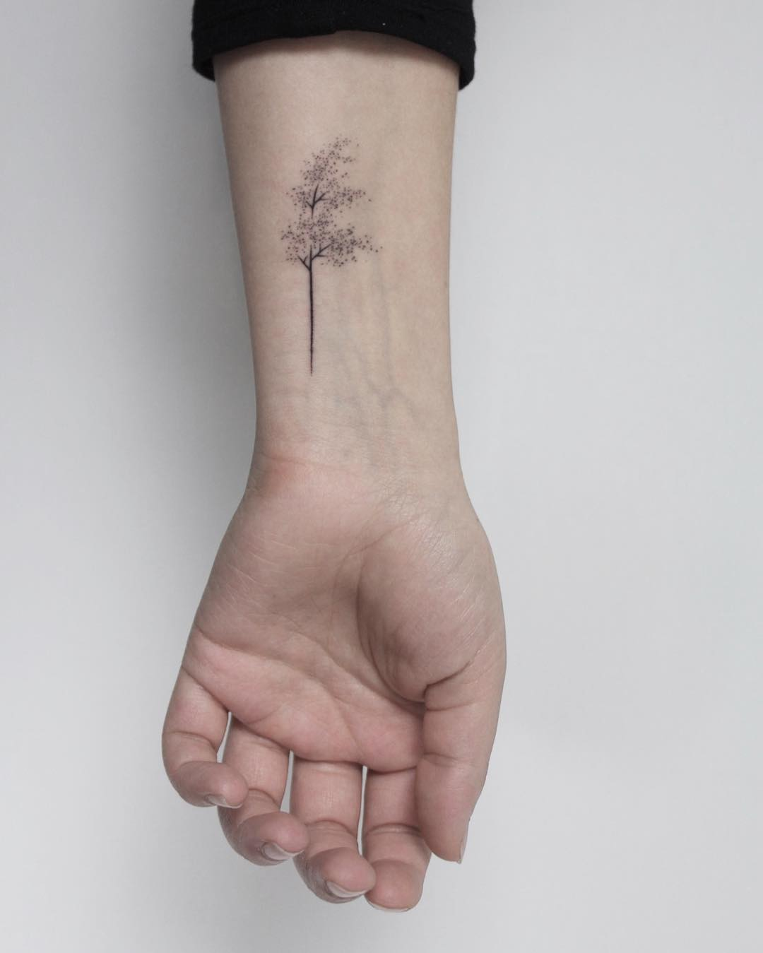 Hand-poked windy tree tattoo by Lara Maju