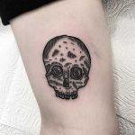 Little woodcut skull tattoo by Deborah Pow