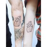 Matching heart tattoos by Zaya Hastra