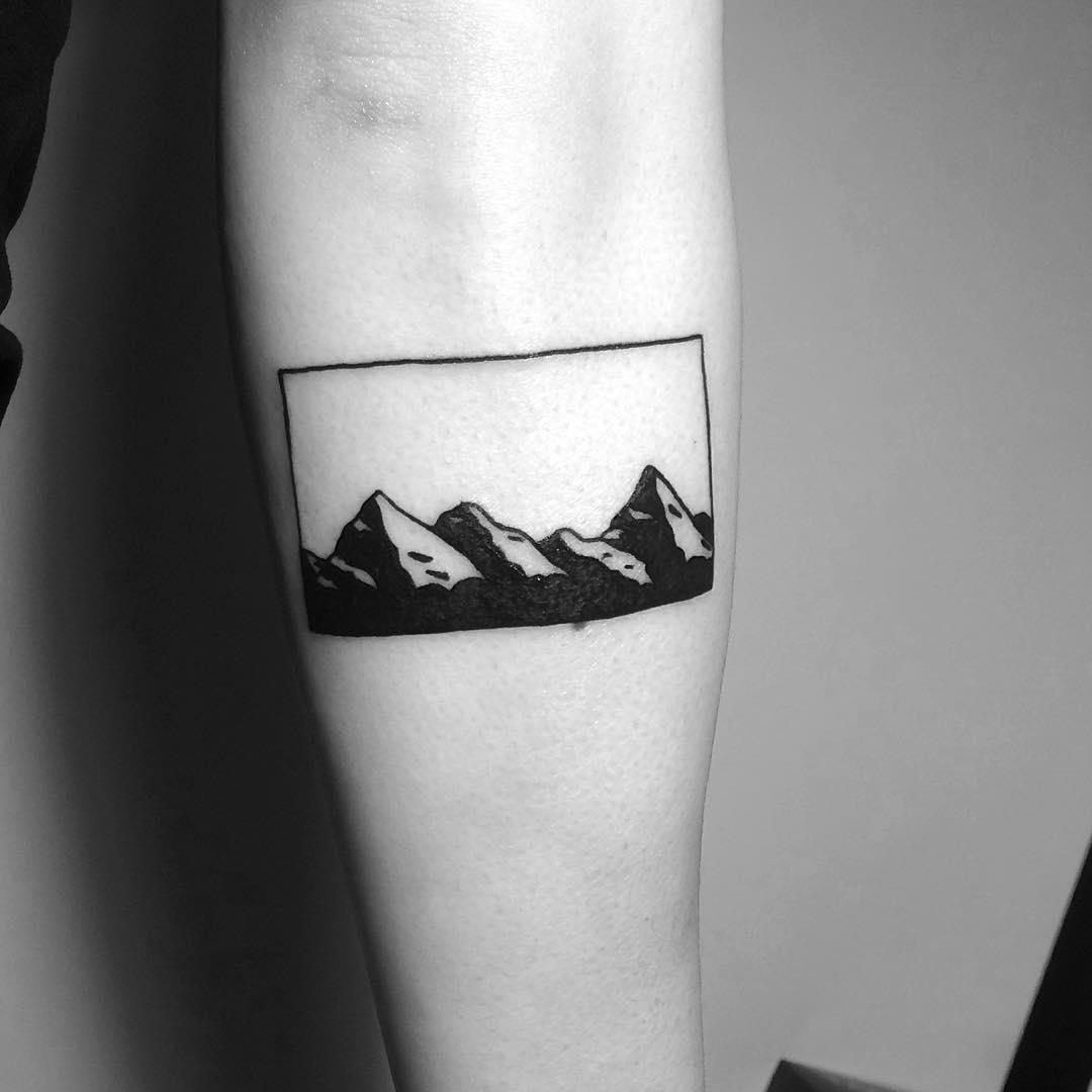 Minimalist mountain range tattoo by Chinatown Stropky