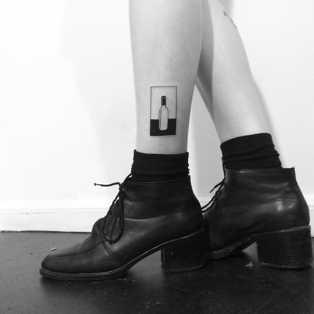 Negative space wine bottle tattoo by Chinatown Stropky
