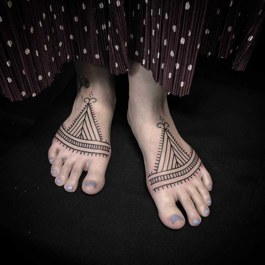 Ornamental feet tattoos by Jaya Suartika