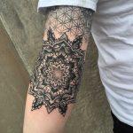 Ornamental mandala on a forearm by Tine DeFiore