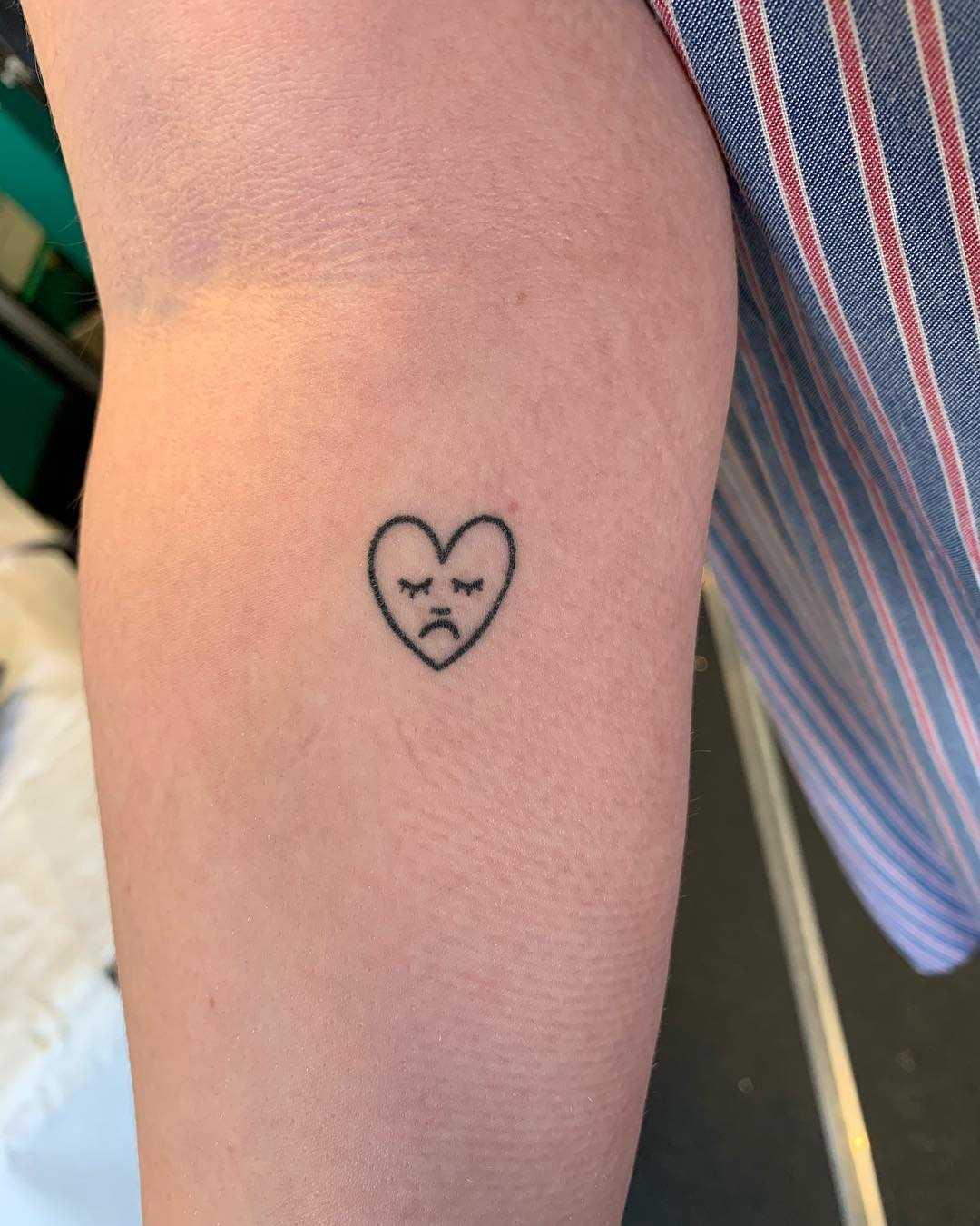 Sad little heart tattoo by Kirk Budden
