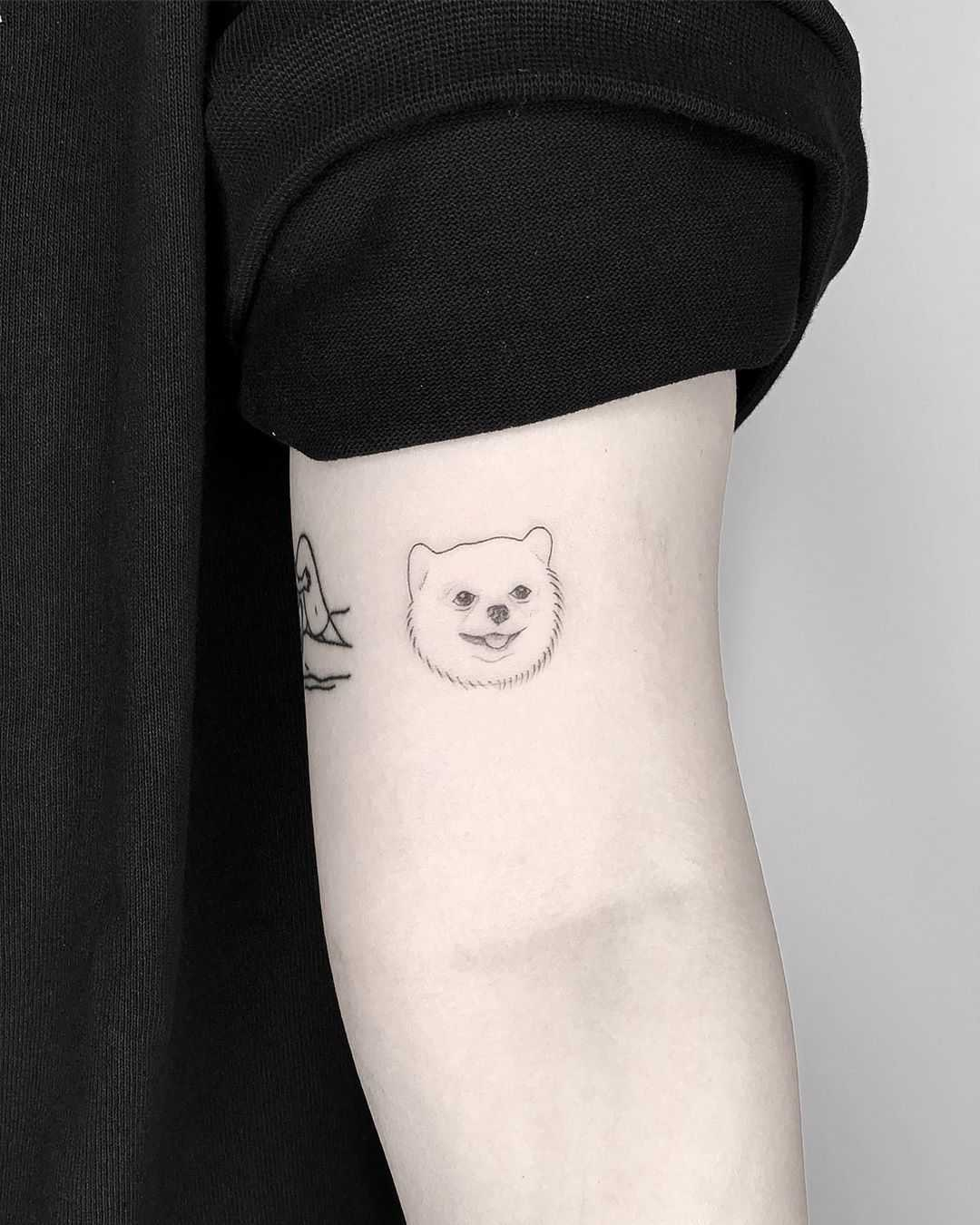 Small pup portrait tattoo by Conz Thomas
