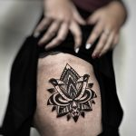 Stylized Lotus tattoo by Mike Nofuck