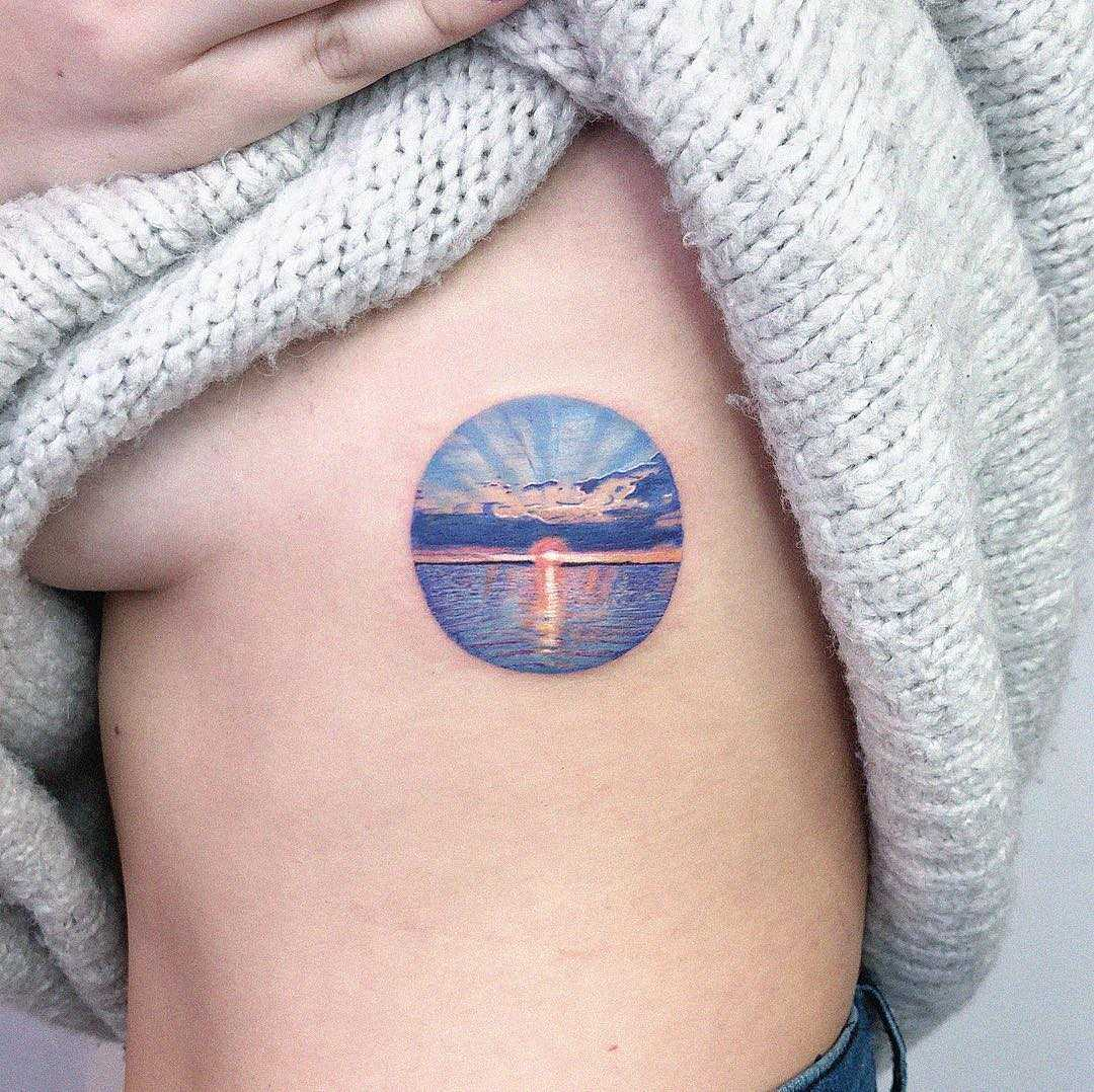 Sunset tattoo by Eden Kozo