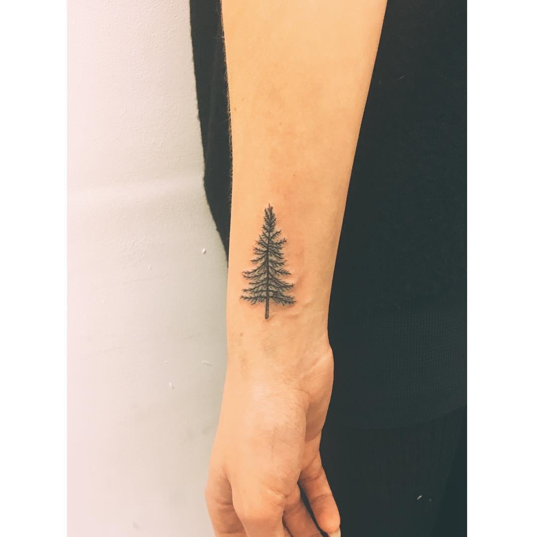 Tiny Christmas tree tattoo by Zaya Hastra