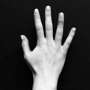 Tiny eye on the ring finger by Nadia Rose