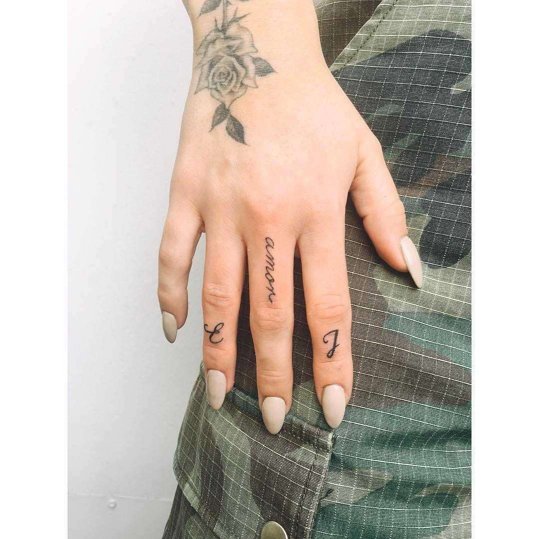 Tiny finger tattoos by Zaya Hastra