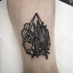 Tiny glass terrarium tattoo by Deborah Pow