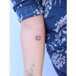 Tiny moon tattoo by Zaya Hastra