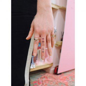 Tiny simple finger tattoos by Zaya Hastra