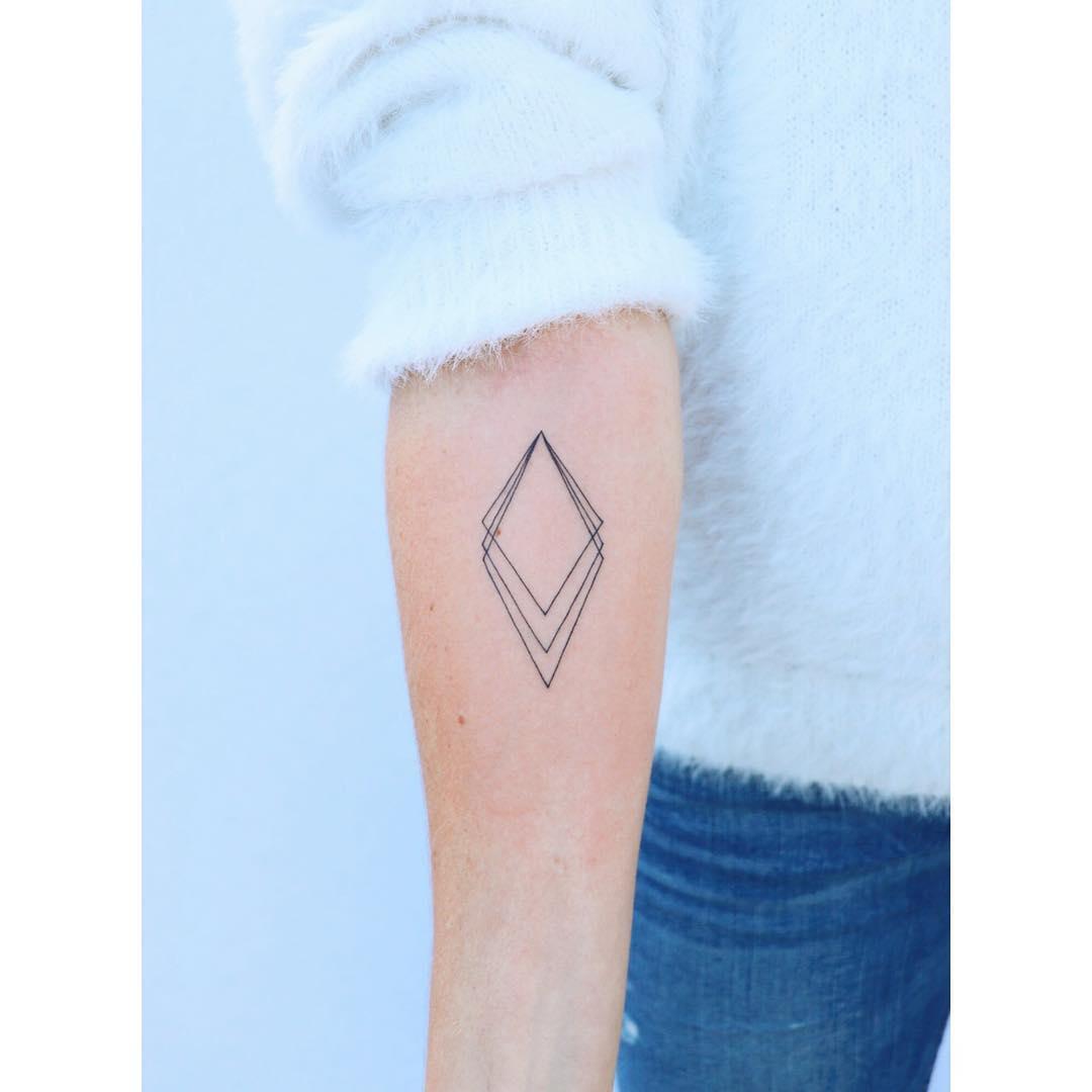 Triple rhombus tattoo by Zaya Hastra