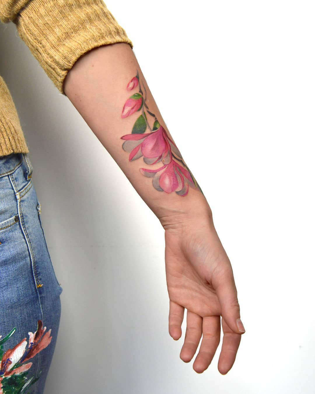 Watercolor flowers on the left forearm by Mavka Leesova