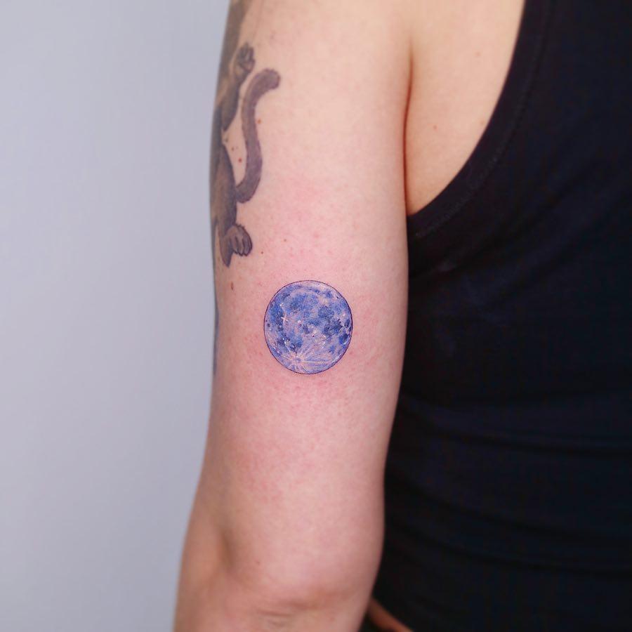 A blue full moon tattoo by tattooist Nemo