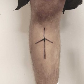 A small windmill tattoo by Annelie Fransson