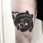 Big croc on a thigh by Deborah Pow