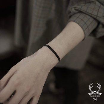 Black bracelet tattoo by Nudy tattooer