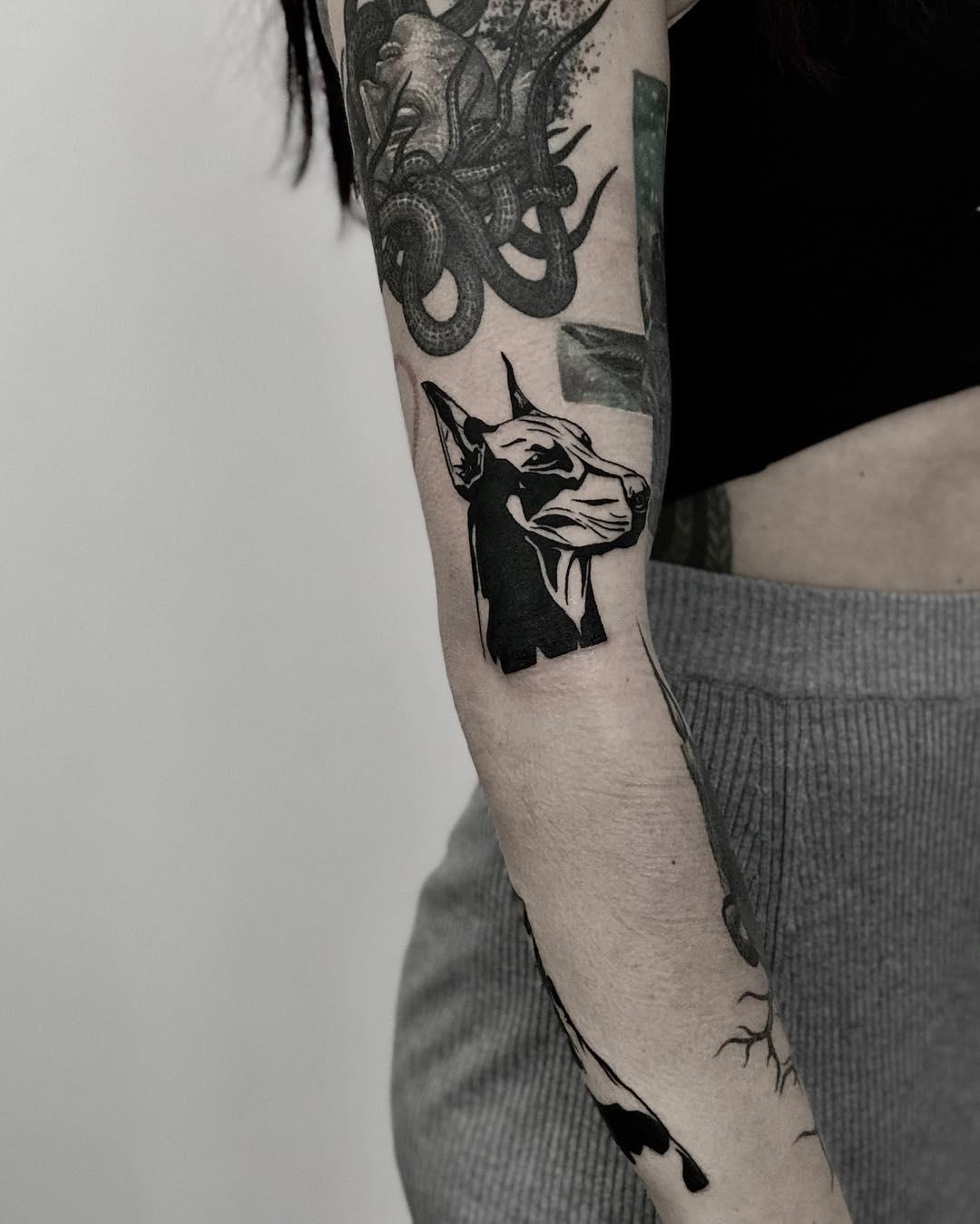 Blackwork doberman tattoo by Krzysztof Szeszko