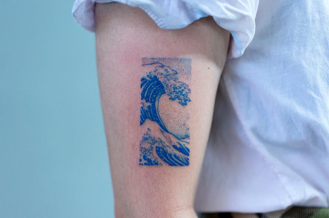 Blue wave tattoo by tattooist Oozy