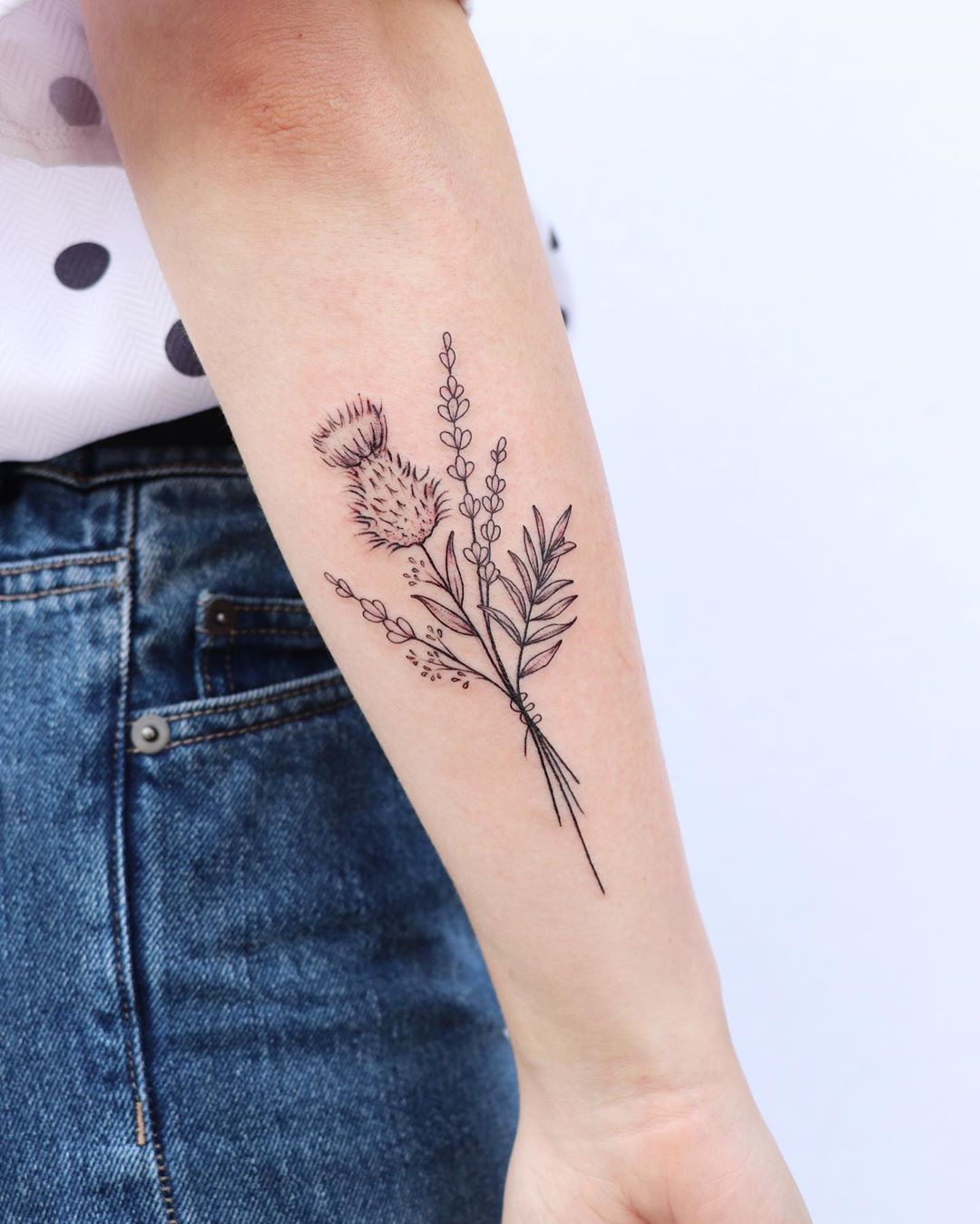 Bouquet of thistle, lavender, and gypsophilia tattoo by Zaya Hastra
