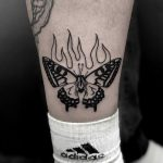 Burning butterfly tattoo by Loz McLean