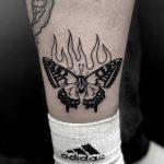 Burning butterfly tattoo by Loz McLean