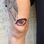 Colorful eye tattoo byEugene Dusty Past