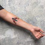 Colorful moth tattoo by Mavka Leesova