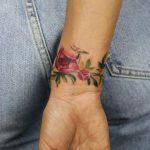 Cover-up floral bracelet tattoo by Mavka Leesova