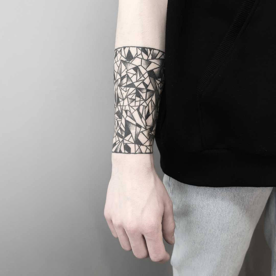 Cubist cover-up tattoo by Julim Rosa