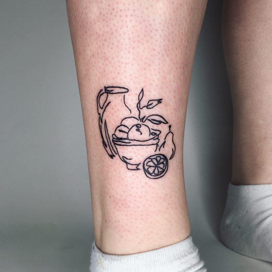 Custom still life tattoo by Suki Lune