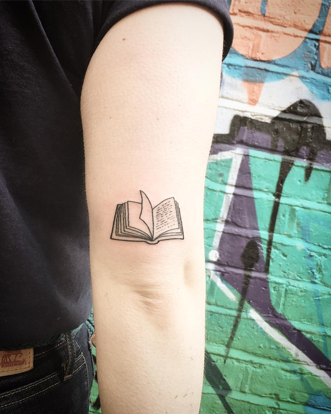 Cute little notebook tattoo by Kirk Budden