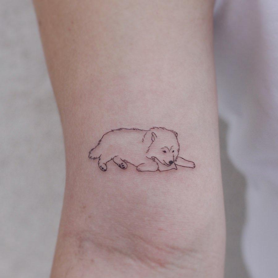Cute lying dog tattoo by tattooist Nemo