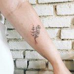 Delicate flowers inked by Kelli Kikcio