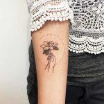 Hand-poked magnolia tattoo by Kelli Kikcio