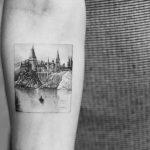 Hogwarts school tattoo by Dragon Ink