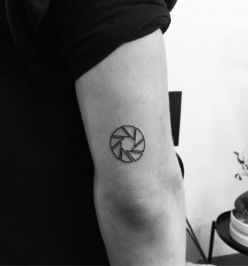 Lense tattoo by Philipp Eid