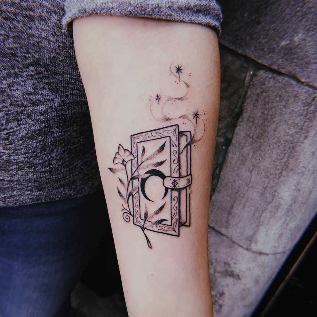 Magic spellbook tattoo by Belladona Hurricane