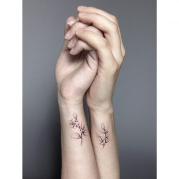 Matching Jasmine tattoos for sisters by Lara Maju