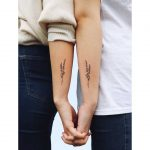 Matching sister tattoos by Zaya Hastra